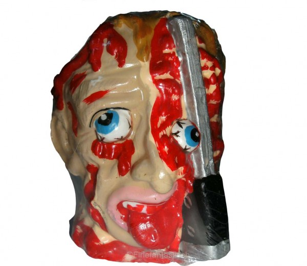 Kerze blutender Kopf mit Messer